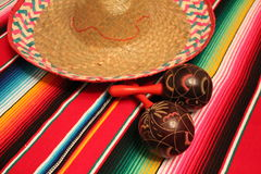 Mexico poncho sombrero maracas background fiesta cinco de mayo decoration bunting. Flags Royalty Free Stock Image