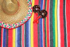 Mexico poncho sombrero maracas background fiesta. With copy space royalty free stock photography