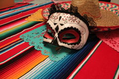 Mexico poncho sombrero skull background fiesta cinco de mayo Stock Photo