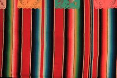 Mexico poncho sombrero skull background fiesta cinco de mayo decoration bunting. Flags Stock Photo