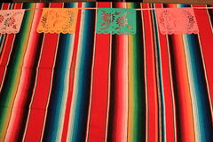 Mexico poncho sombrero skull background fiesta cinco de mayo decoration bunting. Flags Stock Photography