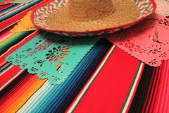 Mexico poncho sombrero skull background fiesta cinco de mayo decoration bunting. Flags stock images