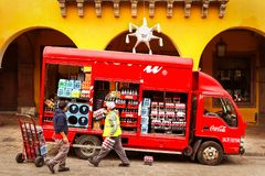 Mexico, San Miguel de Allende, Old Town - January 02, 2019: Workers unload bottles from Coca Cola truck in the old town. Mexico, San Miguel de Allende, Old Town stock images