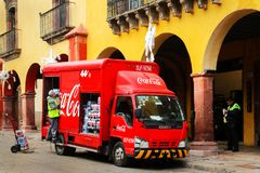 Mexico, San Miguel de Allende, Old Town - January 02, 2019: Workers unload bottles from Coca Cola truck in the old town.  royalty free stock photography