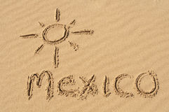 Mexico in the Sand. A picture of the sun and the word Mexico drawn in the sand Royalty Free Stock Images