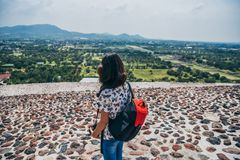 MEXICO - SEPTEMBER 21: GIrl with a camera enjoying the view from the Pyramid of the Sun. September 21, 2017 in Teotihuacan, Mexico Stock Photography