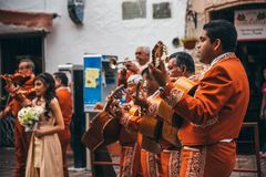 MEXICO - SEPTEMBER 23: Mariachi band performing on the street, S stock photography