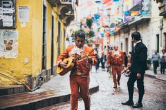 MEXICO - SEPTEMBER 23: Mariachi guitar player walking in a color stock photo