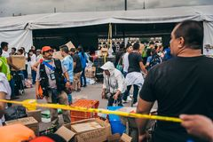 MEXICO - SEPTEMBER 20: People volunteering at a collection center to gather provisions and supplies for the earthquake victims. September 20, 2017 in Mexico royalty free stock photo