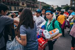 MEXICO - SEPTEMBER 20: People volunteering at a collection center to gather provisions and supplies for the earthquake victims. September 20, 2017 in Mexico royalty free stock images