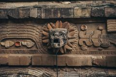 MEXICO - SEPTEMBER 21: Stone head of the serpent god at the Que royalty free stock photography