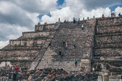 MEXICO - SEPTEMBER 21: Tourists climbing the steps of the Pyramid of the Moon. September 21, 2017 in Teotihuacan, Mexico Stock Image