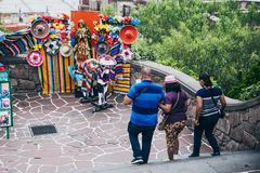 MEXICO - SEPTEMBER 20: Tourists walking at the Tepeyac hills and walking by some traditional mexican decoration. September 20, 2017 in Mexico City, Mexico Royalty Free Stock Images