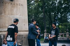 MEXICO - SEPTEMBER 20: Young men having a rap battle at the Beethoven Plaza in downtown while a crowd of people listens. MEXICO - SEPTEMBER 20: Young men having Stock Images