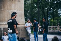 MEXICO - SEPTEMBER 20: Young men having a rap battle at the Beethoven Plaza in downtown while a crowd of people is watchin. G and listening,  September 20, 2017 Royalty Free Stock Images