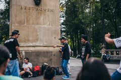 MEXICO - SEPTEMBER 20: Young men having a rap battle at the Beethoven Plaza in downtown while a crowd of people is watching. And listening,  September 20, 2017 Royalty Free Stock Image