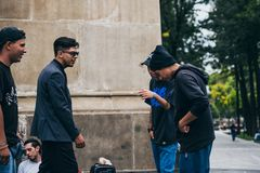 MEXICO - SEPTEMBER 20: Young men having a rap battle at the Beethoven Plaza in downtown while a crowd of people is watching. And listening,  September 20, 2017 Stock Images