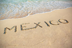 Mexico sign on the beach. Of Caribbean Sea Stock Photo