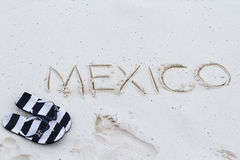 Mexico sign. Mexico written on the beach with wave Royalty Free Stock Photos