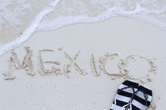 Mexico sign. Mexico written on the beach with wave Stock Photography