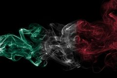 Mexico national smoke flag. Mexico smoke flag isolated on a black background royalty free stock photo