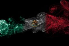 Mexico national smoke flag. Mexico smoke flag isolated on a black background stock image