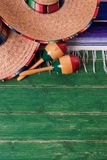 Mexico sombrero border mexican maracas old green wood background royalty free stock photography