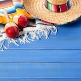 Mexico sombrero cinco de mayo fiesta blue wood background. Mexico sombrero cinco de mayo wood background Royalty Free Stock Image