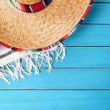 Mexico sombrero cinco de mayo blue wood background. Mexico sombrero cinco de mayo wood background Royalty Free Stock Photo