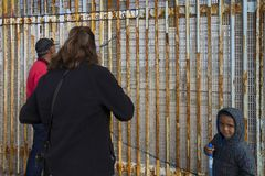 Mexico - Tijuana - The wall of shame. Relatives meets separated from the wall Stock Images