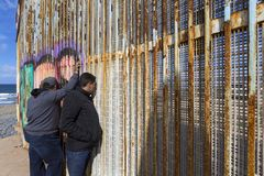 Mexico - Tijuana - The wall of shame. Relatives meets separated from the wall Stock Image