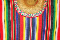 Mexico traditional sombrero cinco de mayo rug poncho fiesta with stripes. Mexican traditional sombrero cinco de mayo rug poncho fiesta with stripes Royalty Free Stock Photo