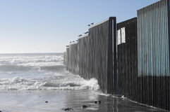 Mexico-United States wall ends up in the Pacific Ocean Royalty Free Stock Image