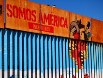 Mexico-USA Border Fence Close to the Pacific Ocean at Tijuana, Mexico with Artwork Translating as `we are America` royalty free stock image