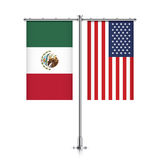 Mexico and USA flags hanging together. Royalty Free Stock Photography