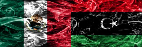 Mexico vs Libya smoke flags placed side by side. Mexican and Lib. Ya flag together vector illustration