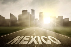 Mexico word on empty road at sunrise royalty free stock photography