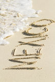 Mexico. Written on the beach with wave Stock Photos