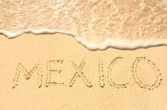 Mexico Written in Sand on Beach. The Word Mexico Written in the Sand on a Beach Stock Photo
