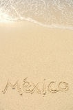 Mexico Written in Sand on Beach. The Word Mexico Written in the Sand on a Beach Stock Images