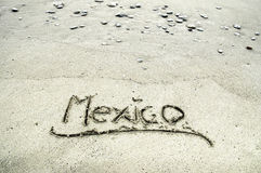 Mexico written in sand Stock Photo