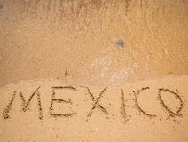Mexico Written in the Sand on a Beach. The Word Mexico Written in the Sand on a Beach Stock Photography