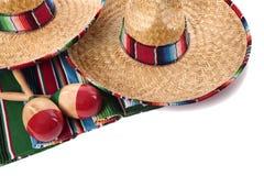 Mexikanische Decke und Sombreros Stockbilder