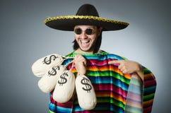 Mexikanischer Mann mit Geldsäcken Stockfotos