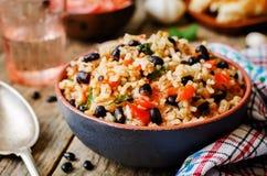 Mexikanischer Reis der schwarzen Bohnen der Tomate mit Koriander Lizenzfreies Stockfoto