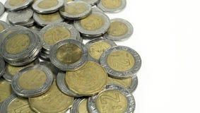 Mexikanisches Pesos, altes und schädigendes Mexiko prägt auf weißem Hintergrund Lizenzfreie Stockbilder