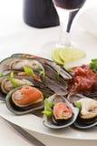 Mexilhões com tomate Foto de Stock