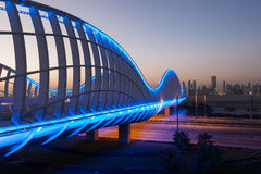 Meydan Bridge illuminated at night. Dubai Royalty Free Stock Image