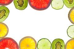 Mezcla de agrios coloridos en blanco Fotos de archivo