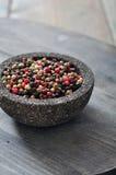 Mezcla de la pimienta en el cuenco de piedra Foto de archivo libre de regalías